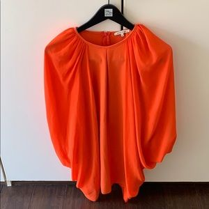 Orange sheet arm cover dress
